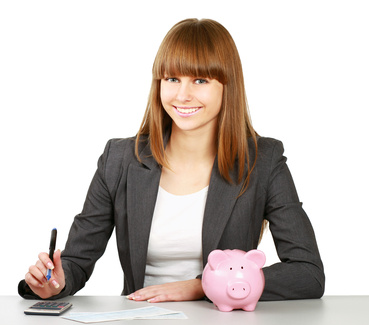 Young woman with a piggy bank and using a calculator, isolated on white background
